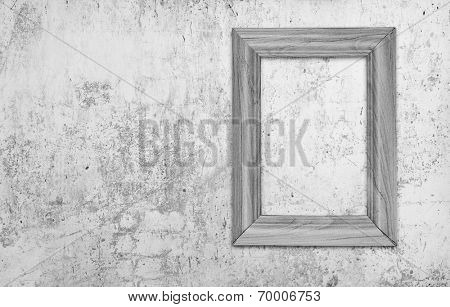 blank photo frame on old gray wall