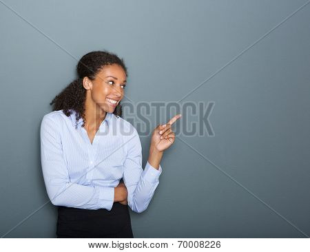 Happy Business Woman Pointing Finger