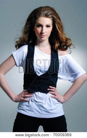 portrait of a young fashion woman posing - Isolated on gray background
