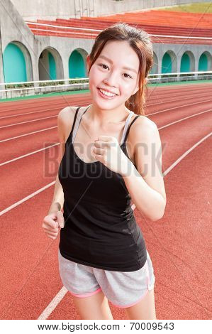 Chinese Woman Jogging At Stadium