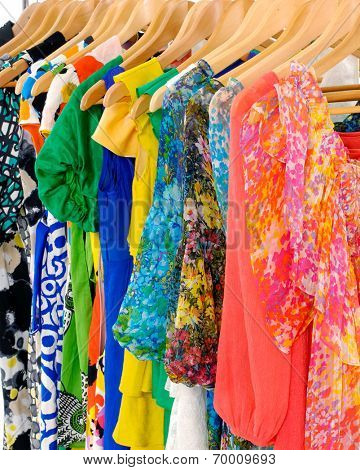 female colorful fashion clothing on hanging