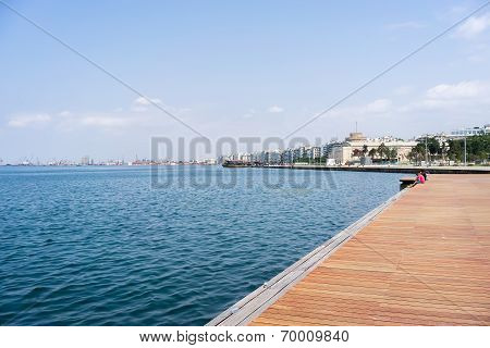 Wooden Platform Beside Sea With Clear Sky At Thessaloniki, Greece.