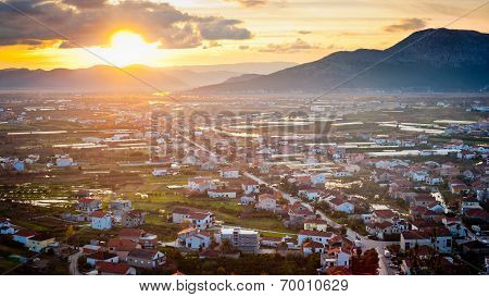 Small Dalmatian City Lit By Sunlight At Sunset