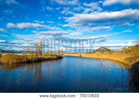 Wetland Area In The South Croatian With Clouds In The Sky