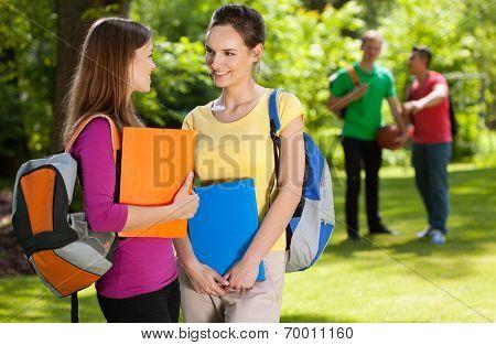 Friends From School Talking In Park