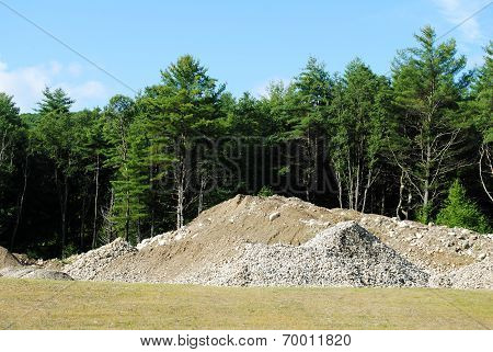 Construction Site With Dirt And Rock Piles