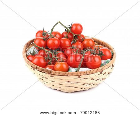 Wicker basket with cherry tomatoes.