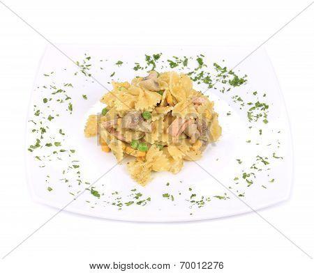 Pasta with ham and mushrooms in sauce pesto.