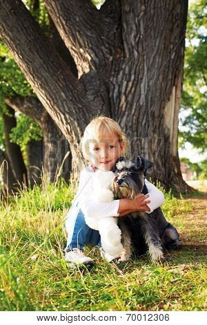 Beautiful Little Girl Hugging Her Dog