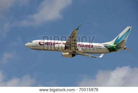 Caribbean Airlines Passenger Jet Takes Off Into Blue Sky