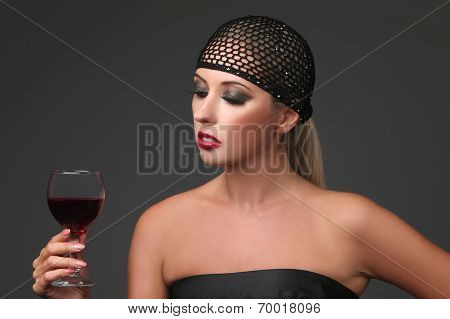 Portrait of beautiful young woman with wine glass. Girl in retro style.
