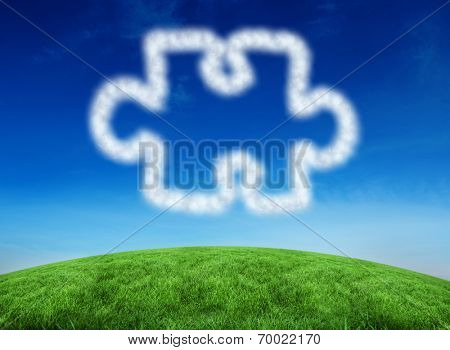 Cloud in shape of jigsaw piece against green hill under blue sky poster