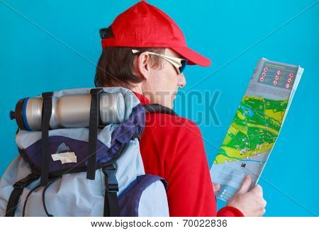 A Man With His Backpack Begins A Hike