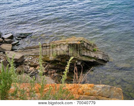 Nature Of Lake Baikal. Ledges Of The Rocks Above Water