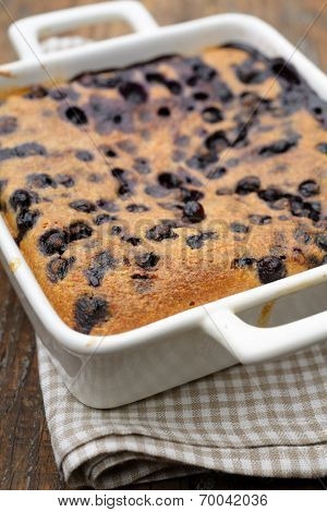 Black currant clafoutis in a baking dish