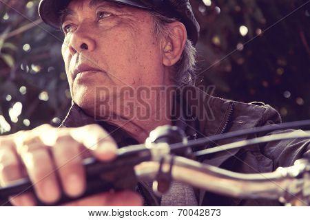 A shot of a senior asian man riding his bicycle