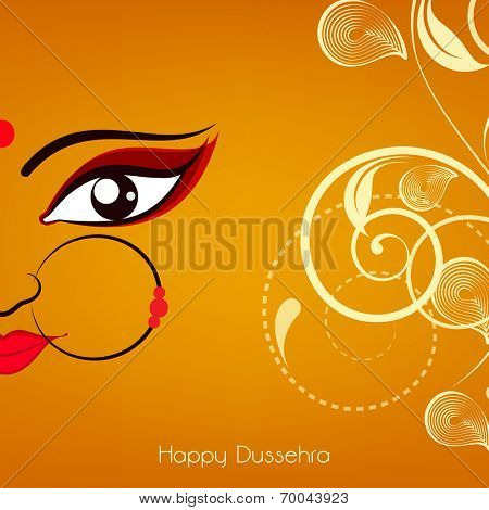 Beautiful half face of smiling  Goddess Durga with big nice eyes and wearing a nose ringwith red pearl on a florel background.