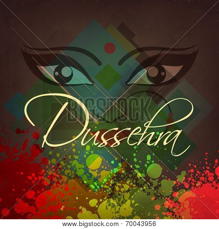 Beautiful eyes on Hindu mythological Goddess Durga on colorful grungy background for Dussehra celebrations.