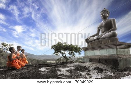 Lord Buddha Day or Vesak Day Buddhist monk praying to the Buddha