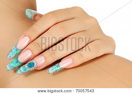 Female hand with long fingernails