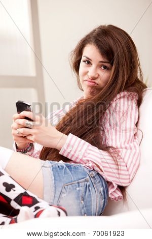 Girl Holding A Grouch Against Mobile Phone