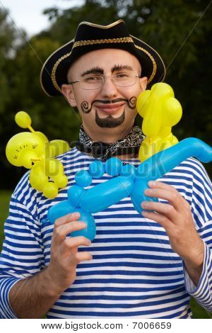 smiling man with drawed beard and whiskers in pirate suit with three air-ballons