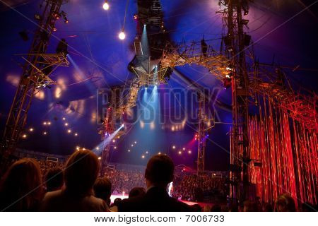 Spectators watch representation of Cirque du Soleil