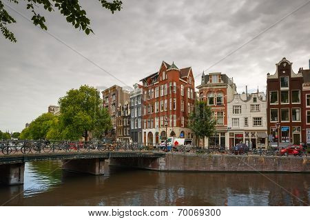 City View Of Amsterdam Canal Singel And Typical Houses, Holland, Netherlands.