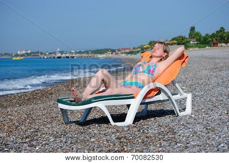 The girl on a sea beach