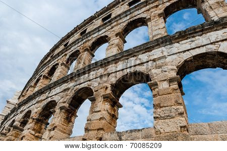 Ancient Roman Amphitheater in Pula. Croatia. It was constructed in 27 BC - 68 AD and is among six largest surviving Roman arenas in the World. Pula Arena is best preserved ancient monument in Croatia. poster