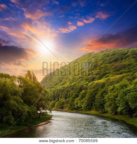 Mountain River Near The Forest At Sunset