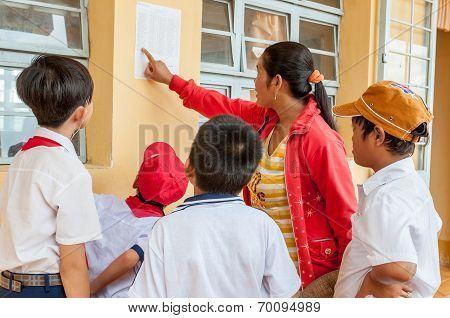 Pupils reading a class list