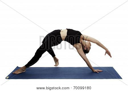 Young Beautiful Yoga Posing On A White Studio Background.