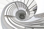 The White spiral stairs of a building poster
