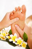 Exotic foot massage and spa foot treatment. poster