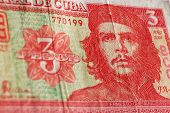A three pesos banknote from the Central Bank of Cuba showing the revolutionary hero Che Guevara. poster