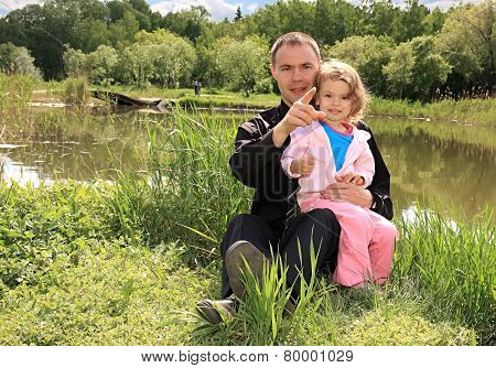 Dad with daughter on nature.