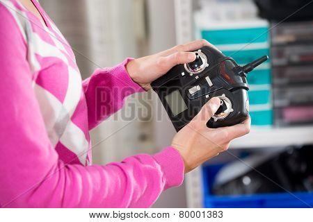 Hands holding a transmitter