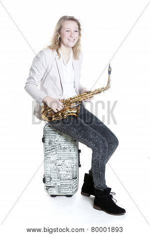 Teenage Blonde Girl With Saxophone On Suitcase With Musical Notes