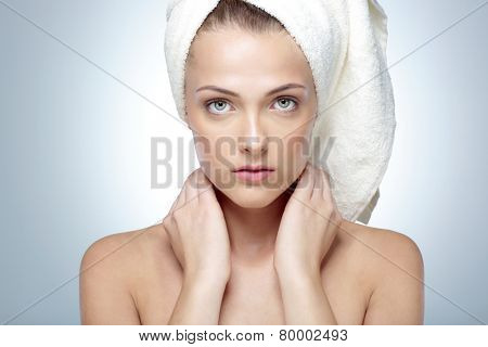 Closeup portrait of young beautiful woman after bath