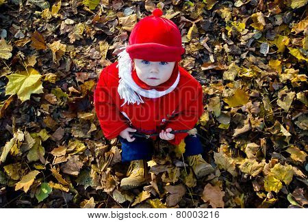 Cute Adorable Girl Portrait In Colorful Autumnal Park
