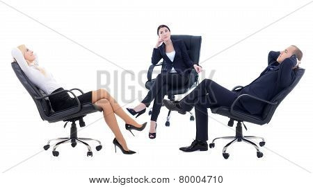 Three Business Persons Sitting On Office Chairs Isolated On White