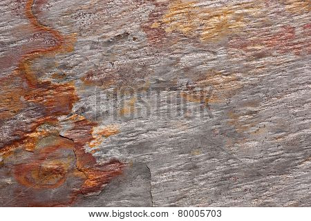 Pattern of a stone slab in silver-gray and rust