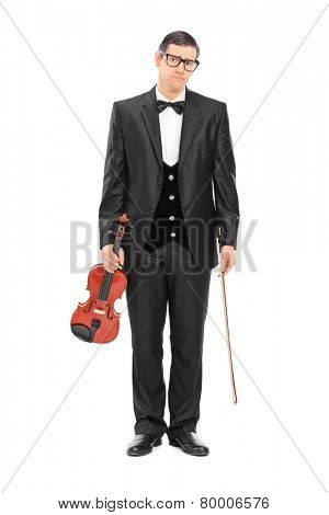 Full length portrait of a sad musician holding a violin isolated on white background