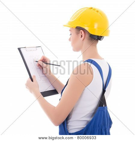 Back View Of Young Woman Builder Writing Something On Building Plan Isolated On White