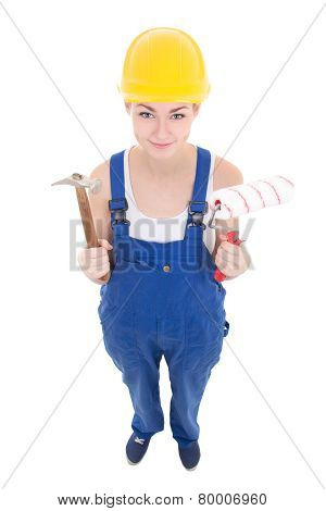 Young Attractive Woman Builder In Workwear With Hammer And Paintbrush Isolated On White
