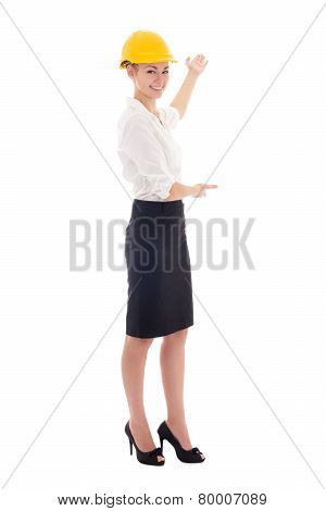 Happy Business Woman Architect In Yellow Builder Helmet Presenting Something Isolated On White