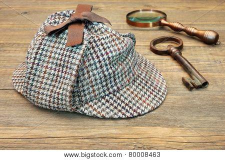 Deerstalker Hat, Retro Magnifying Glass And Large Old Key