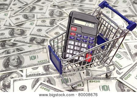 Shopping Cart With Calculator And 2015 Sign On The Display
