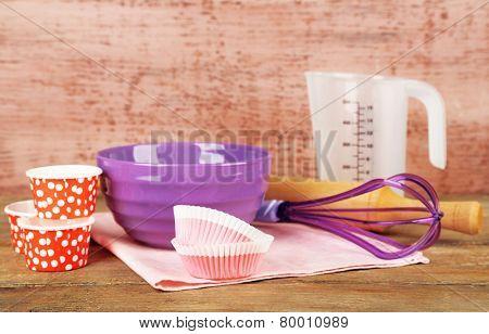 Modern kitchen utensils for baking on color wooden background